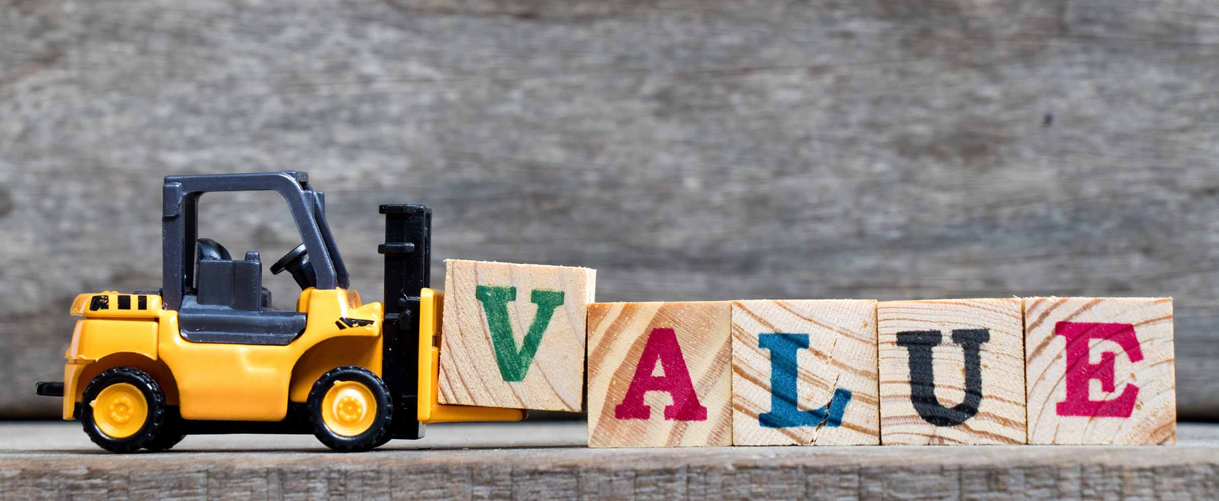 Toy truck assembles cubes that say value