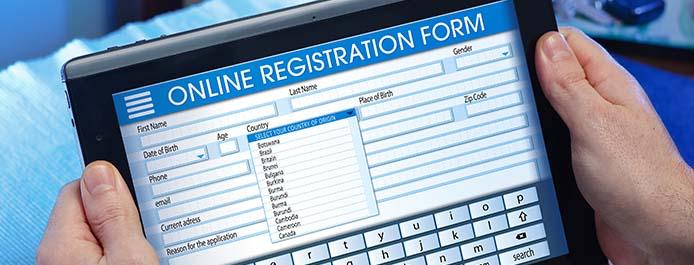 An online registration form on laptop screen