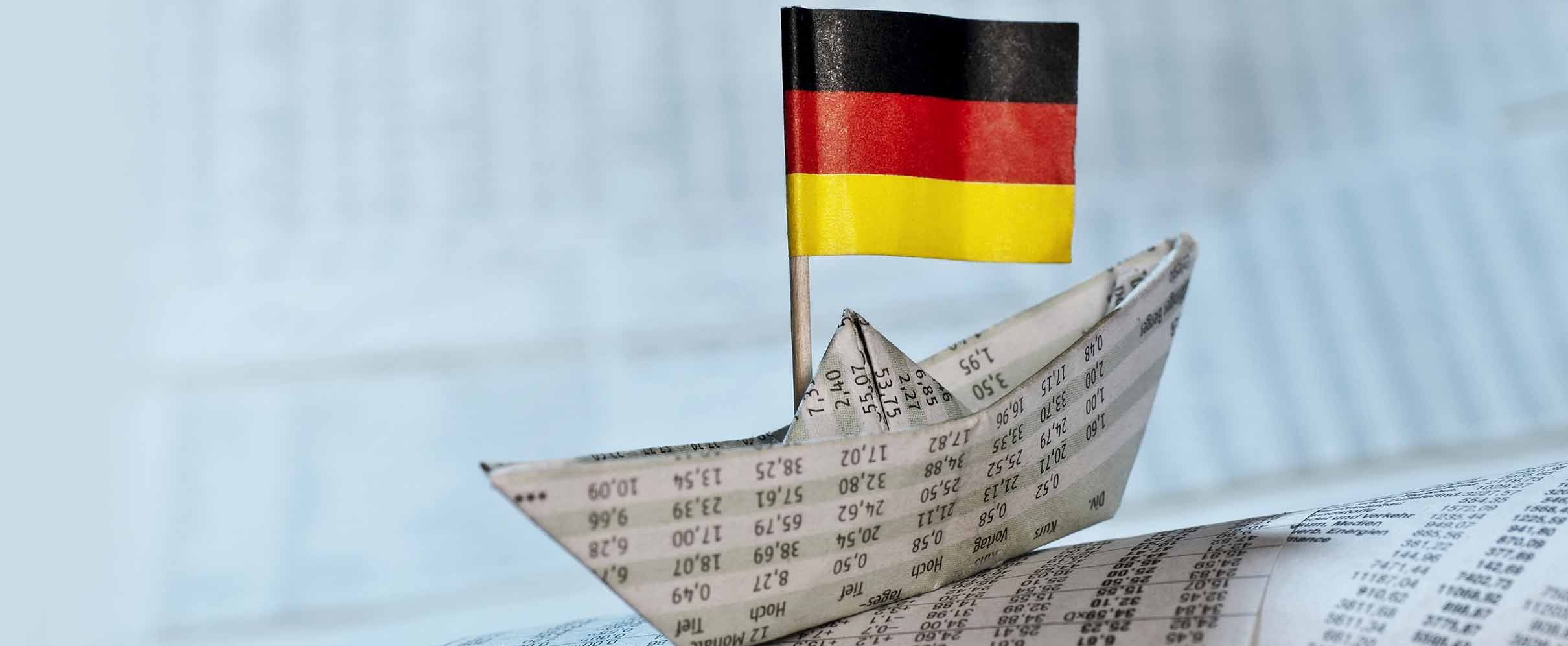 A small paper boat with the German flag.
