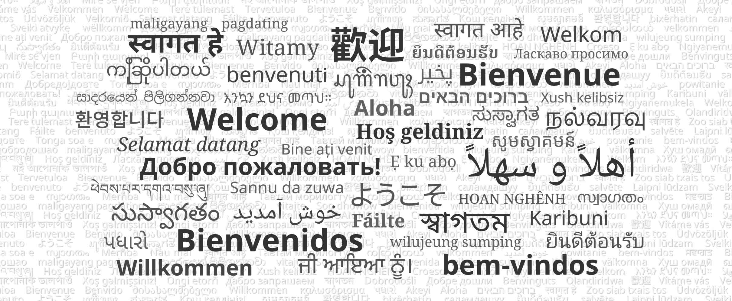 Black and white image showing the phrase 'Welcome' in several languages.