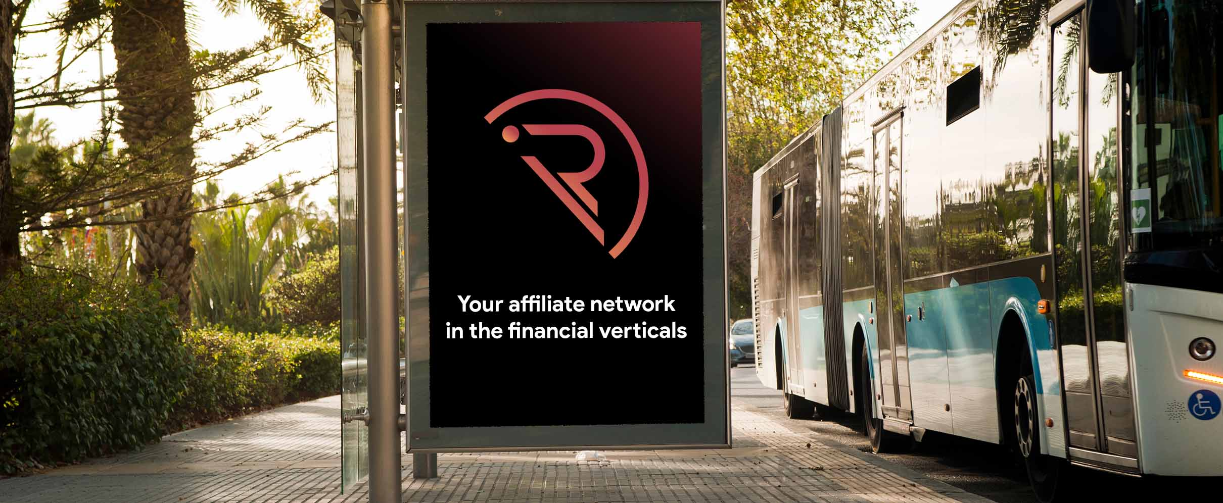 a bus stop that has a big sign that says 'Your affiliate network in the financial verticals'